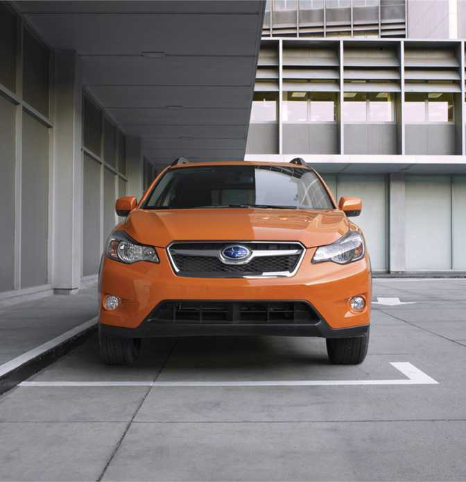 Subaru XV Crosstrek 2.0i Premium (2014) vs BMW 1 Series Convertible 118i (2014)