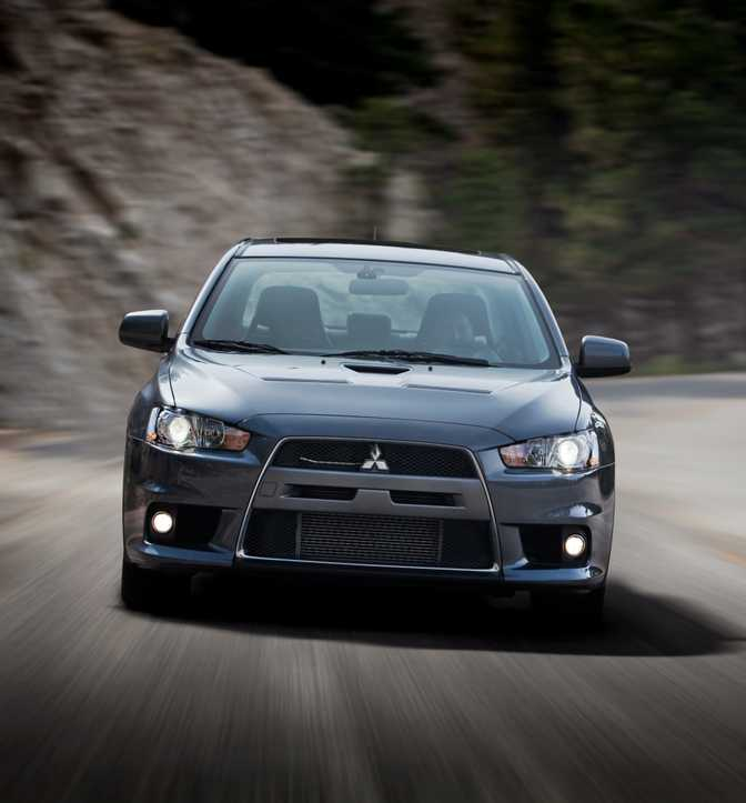 Subaru WRX STI (2015) vs Mitsubishi Lancer Evolution MR (2014)